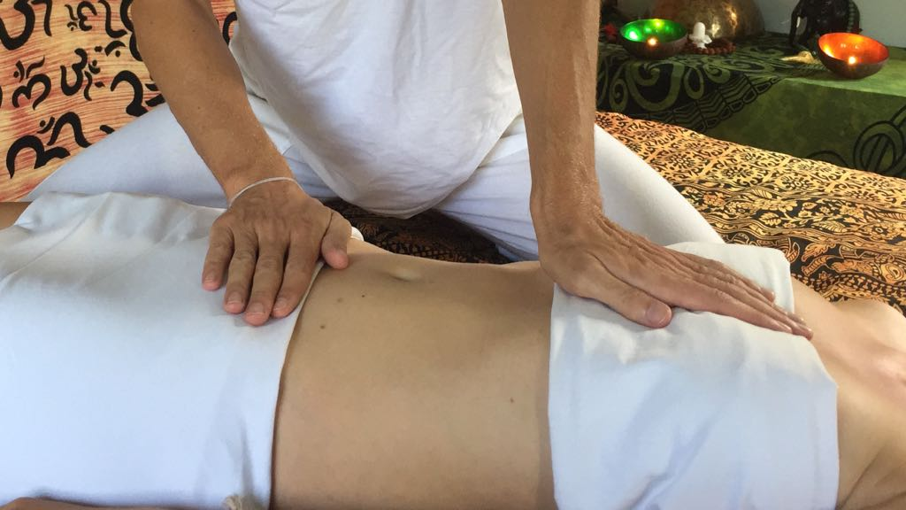 Ayurveda Oil Massage Hands connecting Belly and Heart